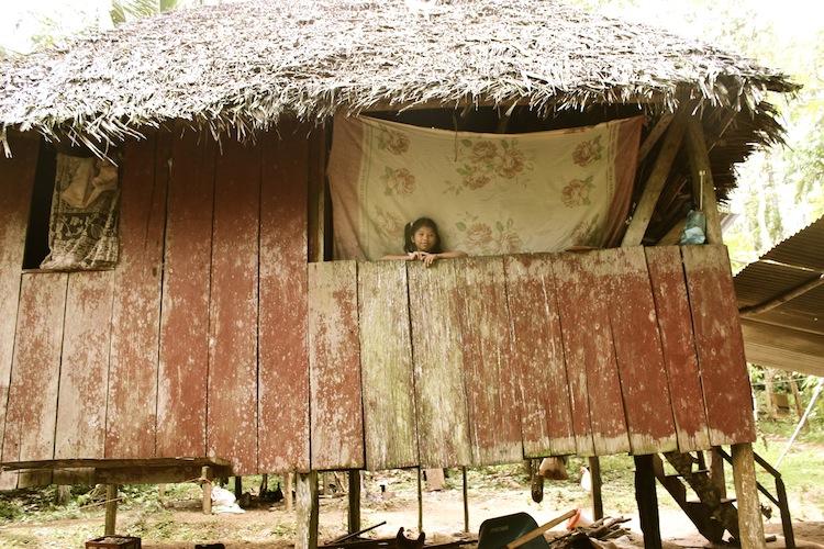 Village girl in her hut