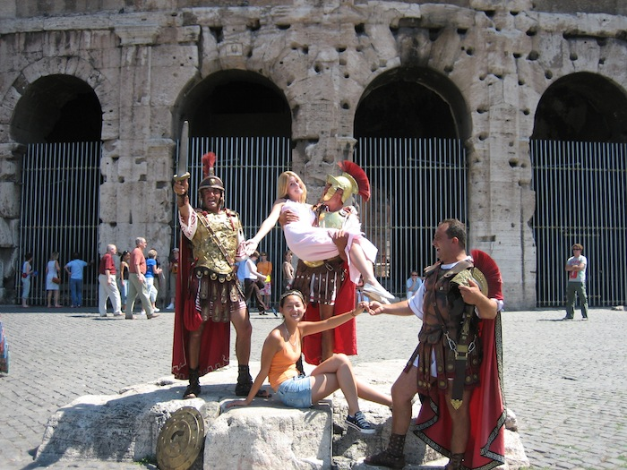 Tourist photo with gladiators at Coliseum in Rome