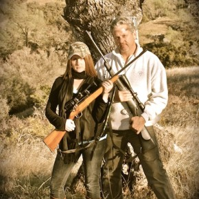 Father daughter portrait with rifles