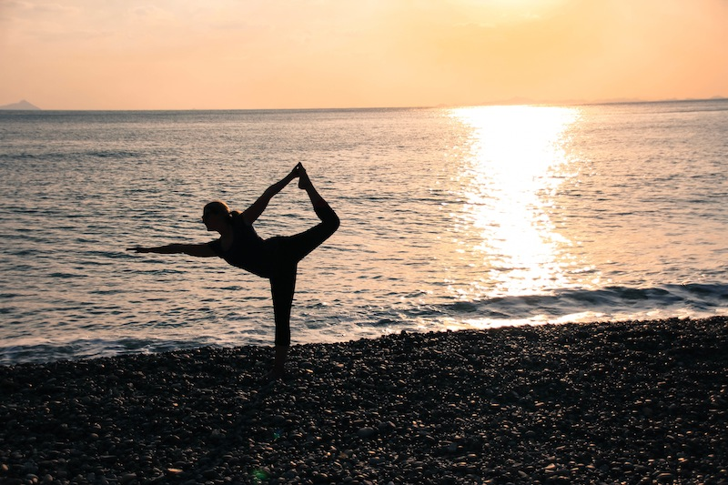 Sunset yoga pose on a beach