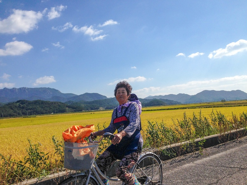 Woman on bike in countryside Korea