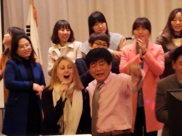 Singing karaoke in Korea with school staff