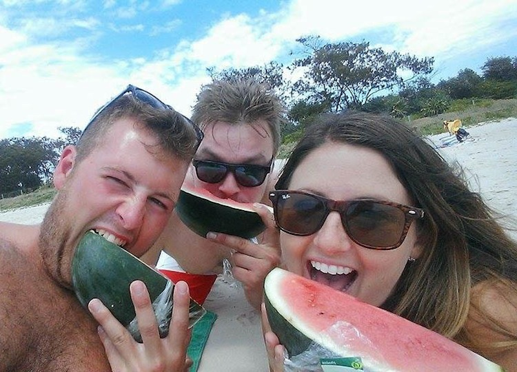 eating watermelon on the beach